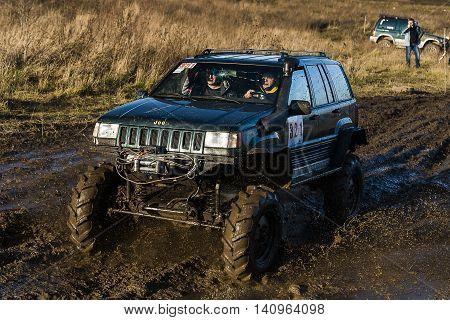 LvivUkraine- December 6 2015: Off-road vehicle brand Jeep Cherokee overcomes the track on a polygon near the city Lviv Ukraine.