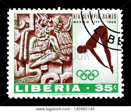 LIBERIA - CIRCA 1968 : Cancelled postage stamp printed by Liberia, that shows Woman diver and Xochicalco.