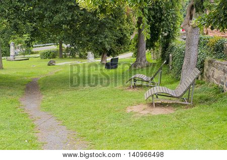 Two loungers to relax in the park.