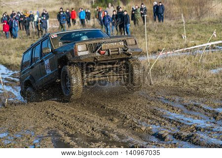 LvivUkraine- December 6 2015: Unknown rider on the off-road vehicle brand Jeep Cherokeel overcomes a route off road near the city of Lviv Ukraine