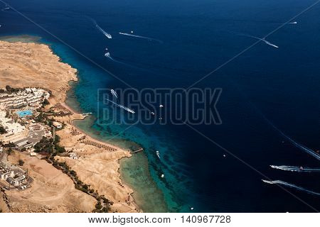 Photo of resort town with hotels and hot climate