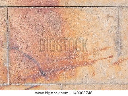 Reddish rusty floor tile background in grungy style.
