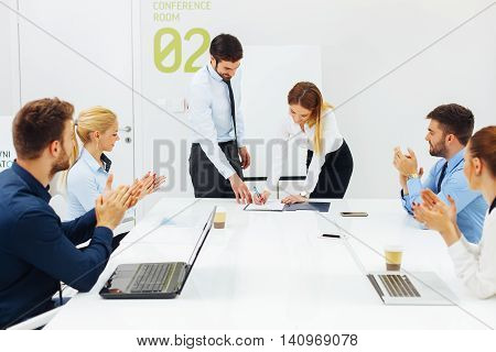 Business people signing the contract  in the conference room