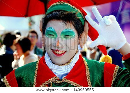 Hong Kong China - January 2 2008: Smiling actor dressed as an elf for the Christmas celebrations at Ocean Park