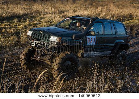 LvivUkraine- December 6 2015: Tuned off-road vehicle brand Jeep Cherokee overcomes the track on a polygon near the city Lviv Ukraine.