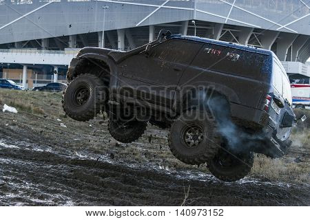 LvivUkraine- December 6 2015: Off-road vehicle brand Nissan overcomes the track on a polygon near the city Lviv Ukraine