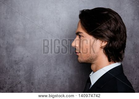 Stylish Man In Formalwear With Stubble And Beautiful Hair, Side-view Photo