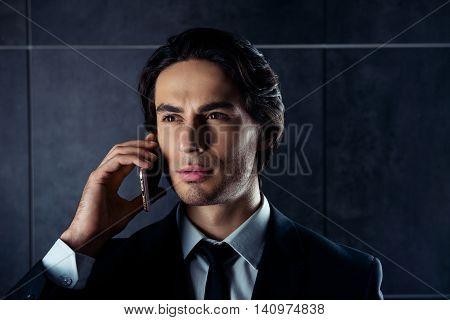 Closeup Portrait Of Handsome  Young Man Talk On Phone