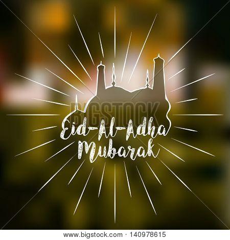 Stylish text Eid-Al-Adha Mubarak with creative Mosque on shiny blured background for Muslim Community, Festival of Sacrifice Celebration.