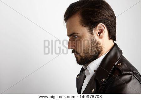 Portrait Young Bearded Man Wearing Stylish Shirt Black Leather Jacket.Beauty, Lifestyle, People Concept Photo.Adult Serious Hipster Guy Empty White Background.Horizontal.Closeup