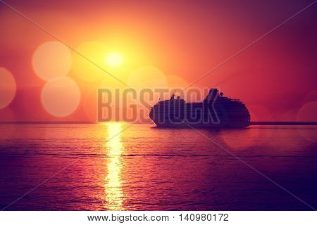 Silhouette of Cruise Ship at Sea Sunset Background. Romantic and Luxury Travel Concept. Toned and Filtered Photo with Bokeh. Copy Space.