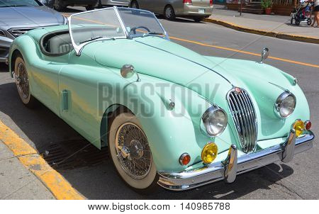 MONTREAL CANADA JULY 30 2016. The Jaguar XK120 is a sports car which was manufactured by Jaguar between 1948 and 1954. The first 242 cars wore wood-framed open 2-seater bodies with aluminium panels.