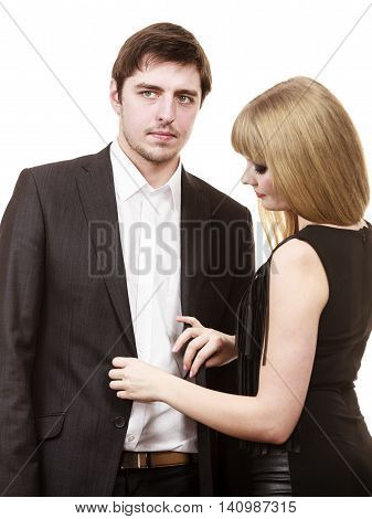 Party and celebration time. Young enamoured couple prepare to celebrate anniversary. Woman helping man dress up. Female buttoning buttons of elegant outfit suit.