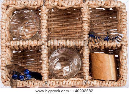 Top view. tableware in the wicker basket cells.