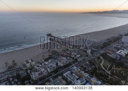 Santa Monica, California, USA - July 21, 2016:  Summer night aerial of crowds at Santa Monica Beach and Pier near Los Angeles, California.
