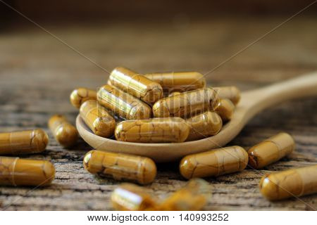 turmeric powder in capsul , asian spice and herb for alternative medicine and food ingredient or spa products