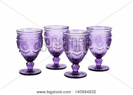 Set of four purple wineglasses with pattern isolated on white