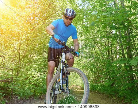 Cyclists Down The Hill Into The Woods.