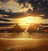 stock photo of the great pyramids  - Sunset over Giza pyramids - JPG