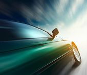 foto of car-window  - Blurred car on road and sky with clouds - JPG