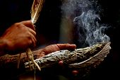 image of american indian  - A Native American uses sage to smudge and bless the victims of war - JPG