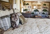 picture of bed breakfast  - A luxury bedroom with den area in background in new model home - JPG