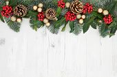 Christmas abstract background  border with flora of holly, ivy, gold baubles and pine cones with sno poster