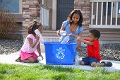 picture of recycling bin  - Three children putting items into recycle bin - JPG