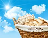 Laundry basket with towels against a blue sky