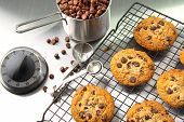 Freshly baked chocolate chip cookies on cooling rack