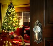 Door opening into a beautiful living room decorated for Christmas