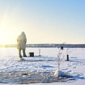 pic of ice fishing  - Fisherman on ice - JPG