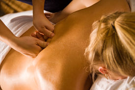 stock photo of spa massage  - woman at a day spa getting a deep tissue massage - JPG