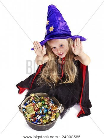 Witch  little girl with candy. Halloween.