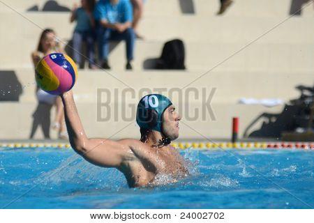 KAPOSVAR, HUNGARY - OCTOBER 1: Miklos Gor Nagy in action at a Hungarian national championship water-polo game between Kaposvar (white) and Honved (green) on October 1, 2011 in Kaposvar, Hungary