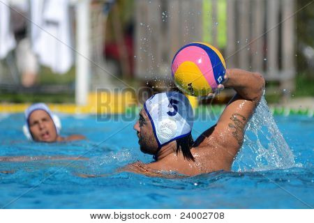 KAPOSVAR, HUNGARY - OCTOBER 1: Verlac Blaz in action at a Hungarian national championship water-polo game between Kaposvar (white) and Honved (green) on October 1, 2011 in Kaposvar, Hungary