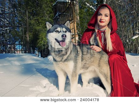 Smiling Red Hood with a wolf