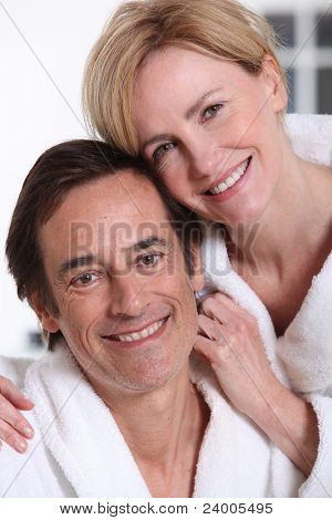 Portrait of loving couple in bathrobes