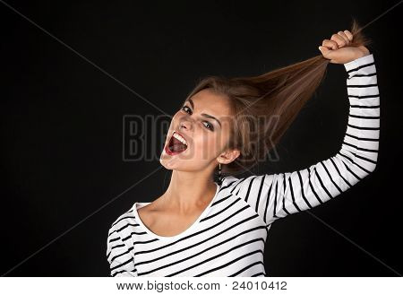 Beautiful Girl In A Striped Dress Pulls His Hair