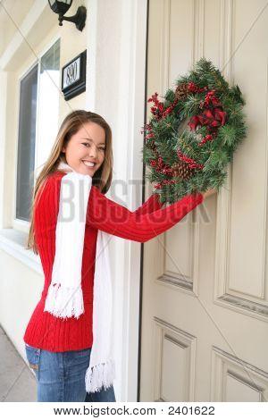 Woman And Christmas Wreath