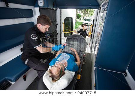 EMT worker feeling pulse in wrist of senior patient