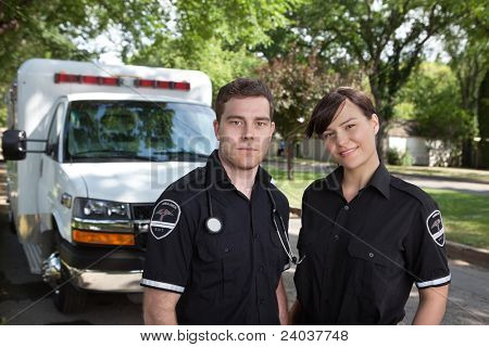 Paramedic team portrait with ambulance in background
