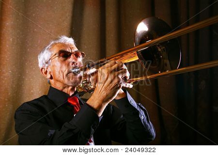 Man in shirt trumpet with might and main