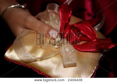 Holding Wedding Bands