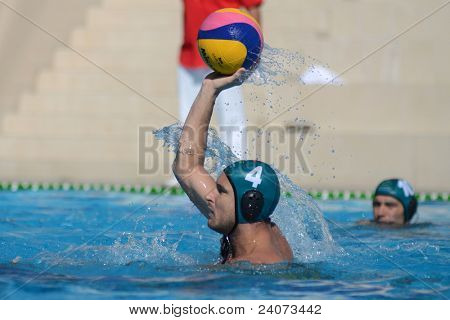 KAPOSVAR, HUNGARY - OCTOBER 1: Zoltan Matyas (green 4) in action at a Hungarian national championship water-polo game Kaposvar (white) vs. Honved (green) on October 1, 2011 in Kaposvar, Hungary
