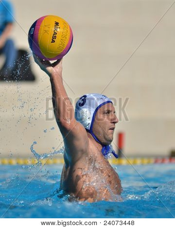 KAPOSVAR, HUNGARY - OCTOBER 1: Gabor Papp (white 3) in action at a Hungarian national championship water-polo game Kaposvar (white) vs. Honved (green) on October 1, 2011 in Kaposvar, Hungary