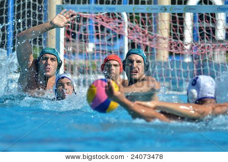 KAPOSVAR, HUNGARY - OCTOBER 1: Unidentified players in action at a Hungarian national championship water-polo game Kaposvar (white) vs. Honved (green) on October 1, 2011 in Kaposvar, Hungary