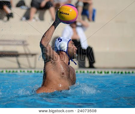 KAPOSVAR, HUNGARY - OCTOBER 1: Blaz Verac (white 5) in action at a Hungarian national championship water-polo game between Kaposvar (white) and Honved (green) on October 1, 2011 in Kaposvar, Hungary