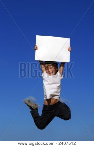 Child Jumping With Blank Card For Copy Space