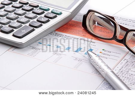 Stock Chart With Calculator,pen And Eyeglasses